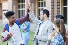 High school principal gives student a high five