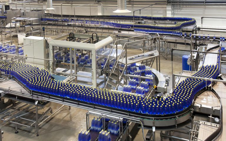 Bottles on production line in bottling pla... By: