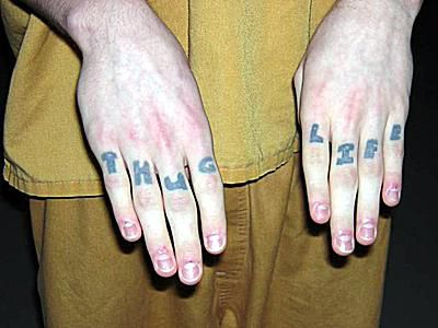 Photos, Symbols, and Meanings of Gang Tattoos