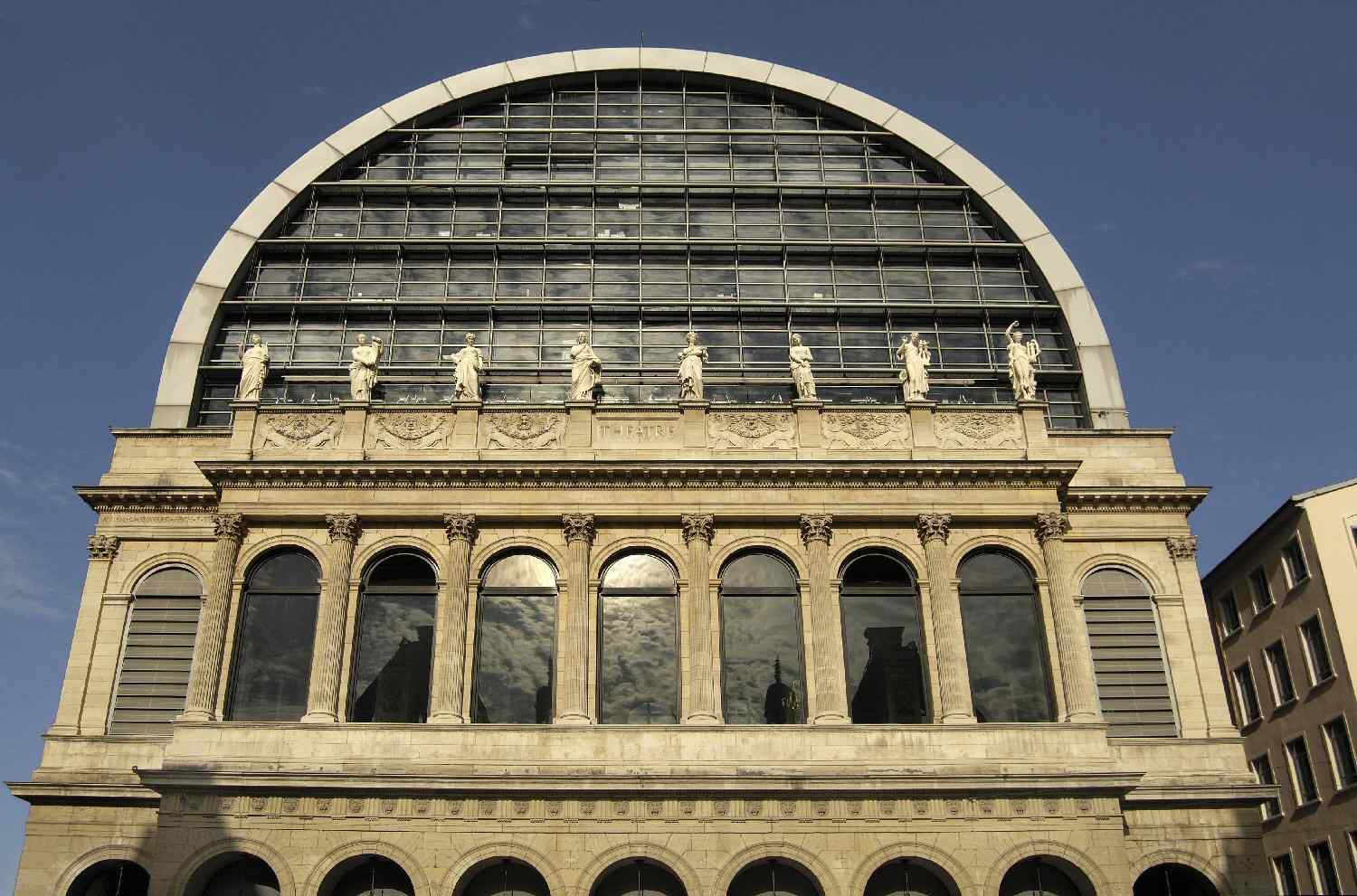 Renovated Lyons Opera House by Jean Nouvel added a glass roof but kept the 1831 facade.