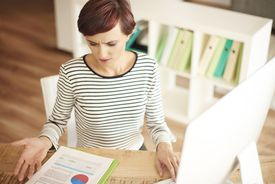 woman looking at misleading information in document