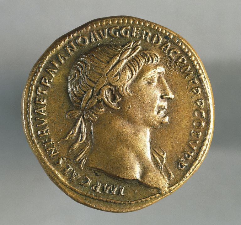 Close up of a coin minted with Trajan's head