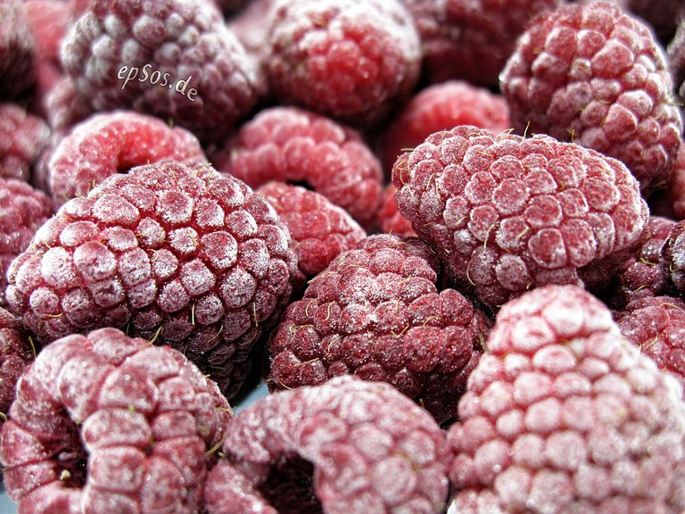 Close up of frozen raspberries.