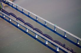 Aerial view of parallel spans of the Benicia-Martinez Bridge, crossing Carquinez Strait in northern California.