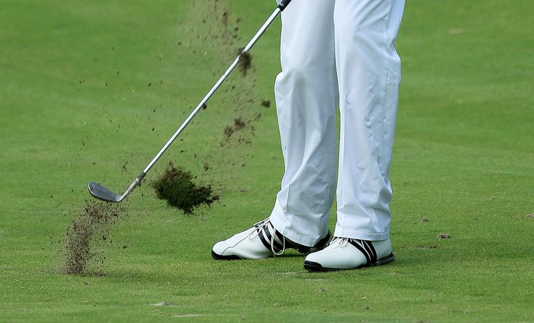 Davis Love III plays a shot from a divot on the tenth hole during the second round of the 93rd PGA Championship at the Atlanta Athletic Club on August 12, 2011