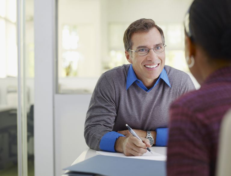 man taking notes for interview