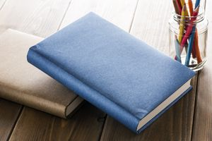 Books with office supplies