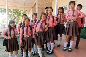 Group of school children in uniform.