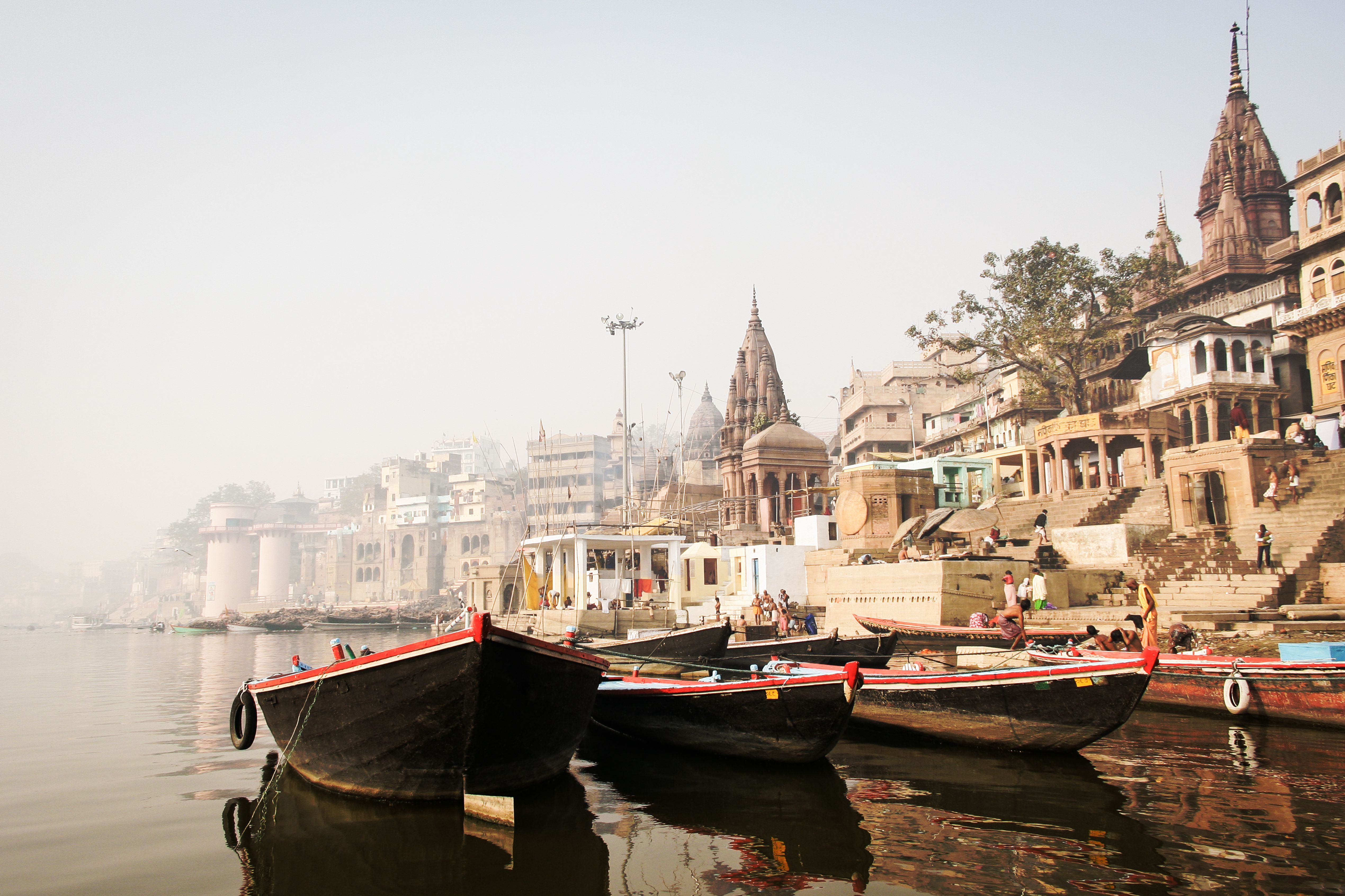 Pleasure boats and ancient Hindu temples on River Ganges