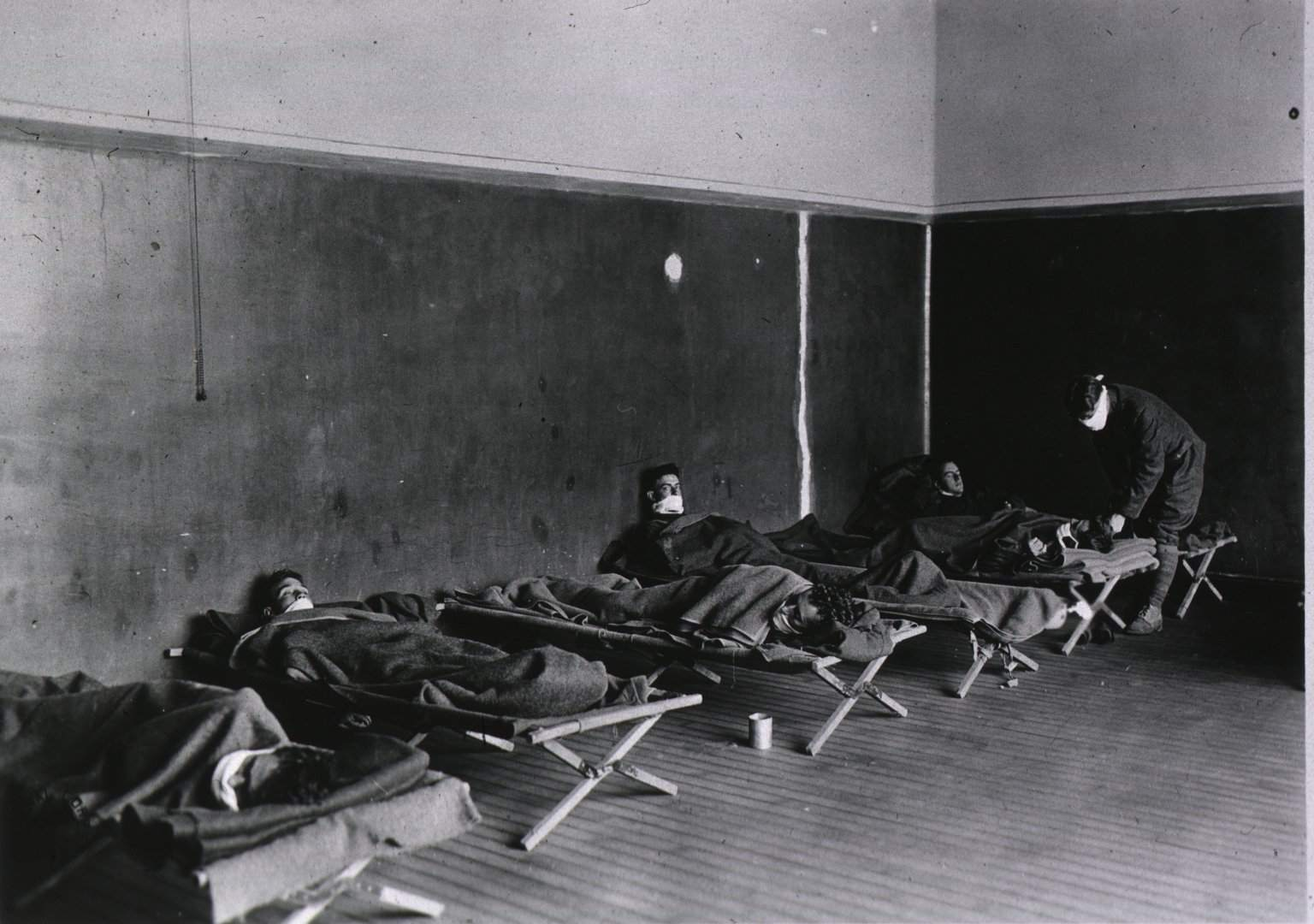 A picture of patients in bed in the influenza ward of a U.S. Army Field Hospital.