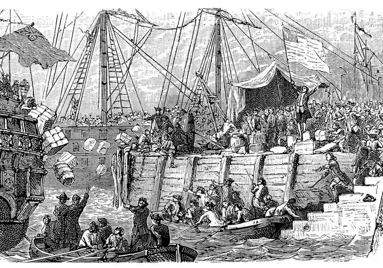 An illustration of the Boston Tea Party, showing people throwing crates of tea out of large ships.