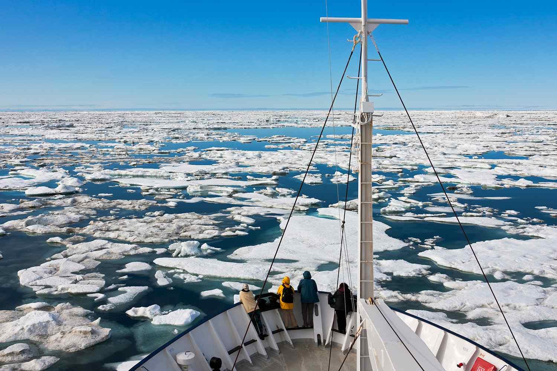 Cruise ship sailing through floating ice on Bering Sea, Russia Far East