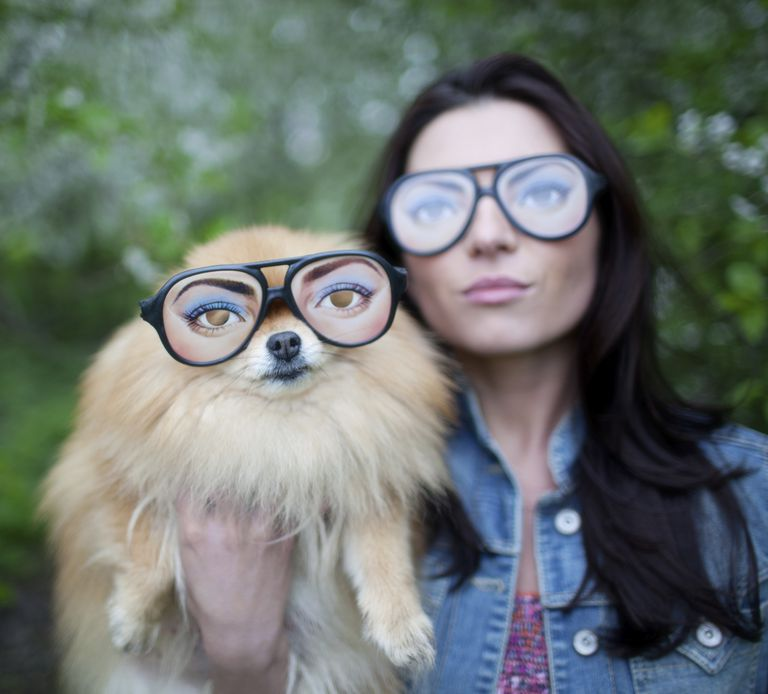 Woman and dog in funny glasses