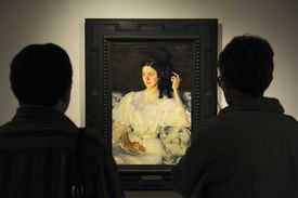 people looking at a painted portrait