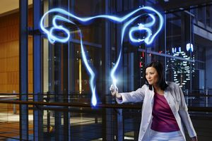 A doctor painting ovaries with light.