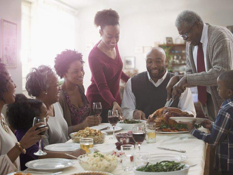 Family serving each other at holiday table