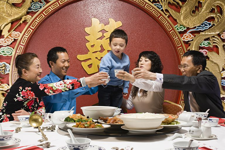 chinese family toasting at reunion dinner