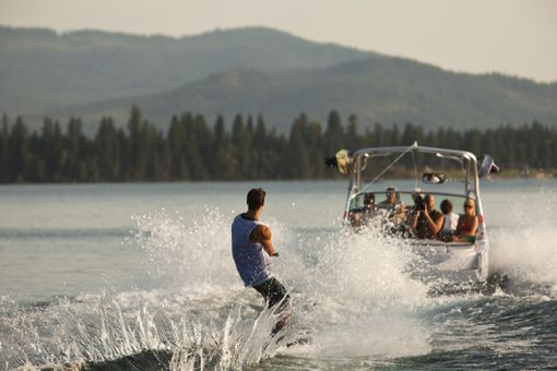 Boat towing a wakeboarder
