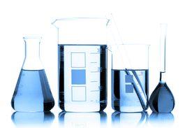 Chemistry glassware containing blue liquids