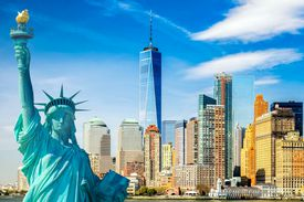 The statue of Liberty in front of New York City's World Trade Center