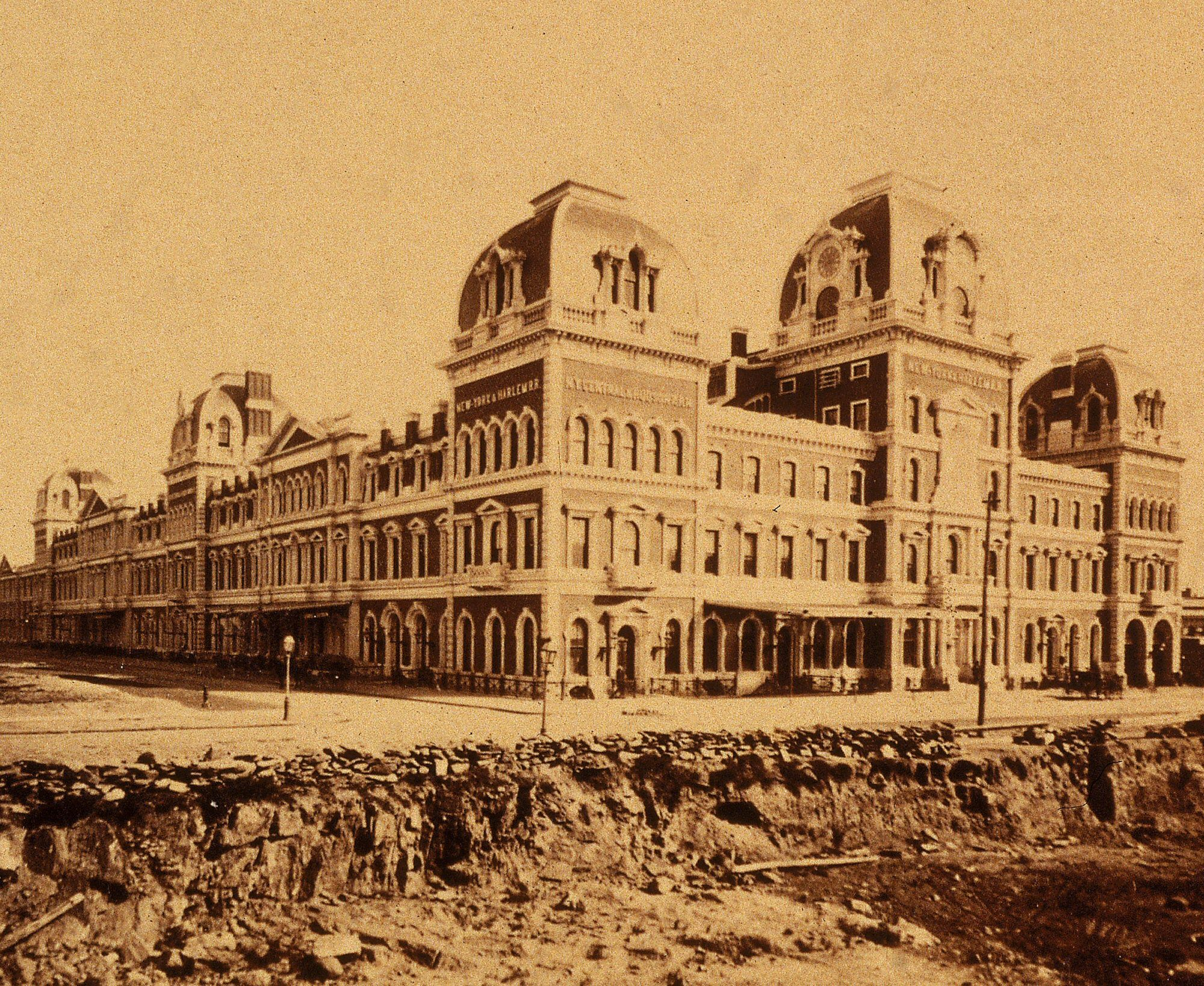Archival photo of Second Empire style building covering an entire city block.