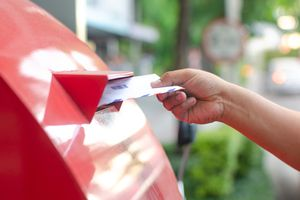 A right hand sending letter to post box