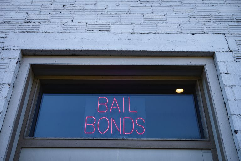 neon bail bond sign in window
