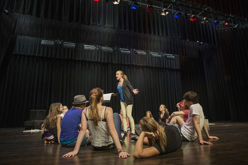 Onstage theater training includes running lines on stage