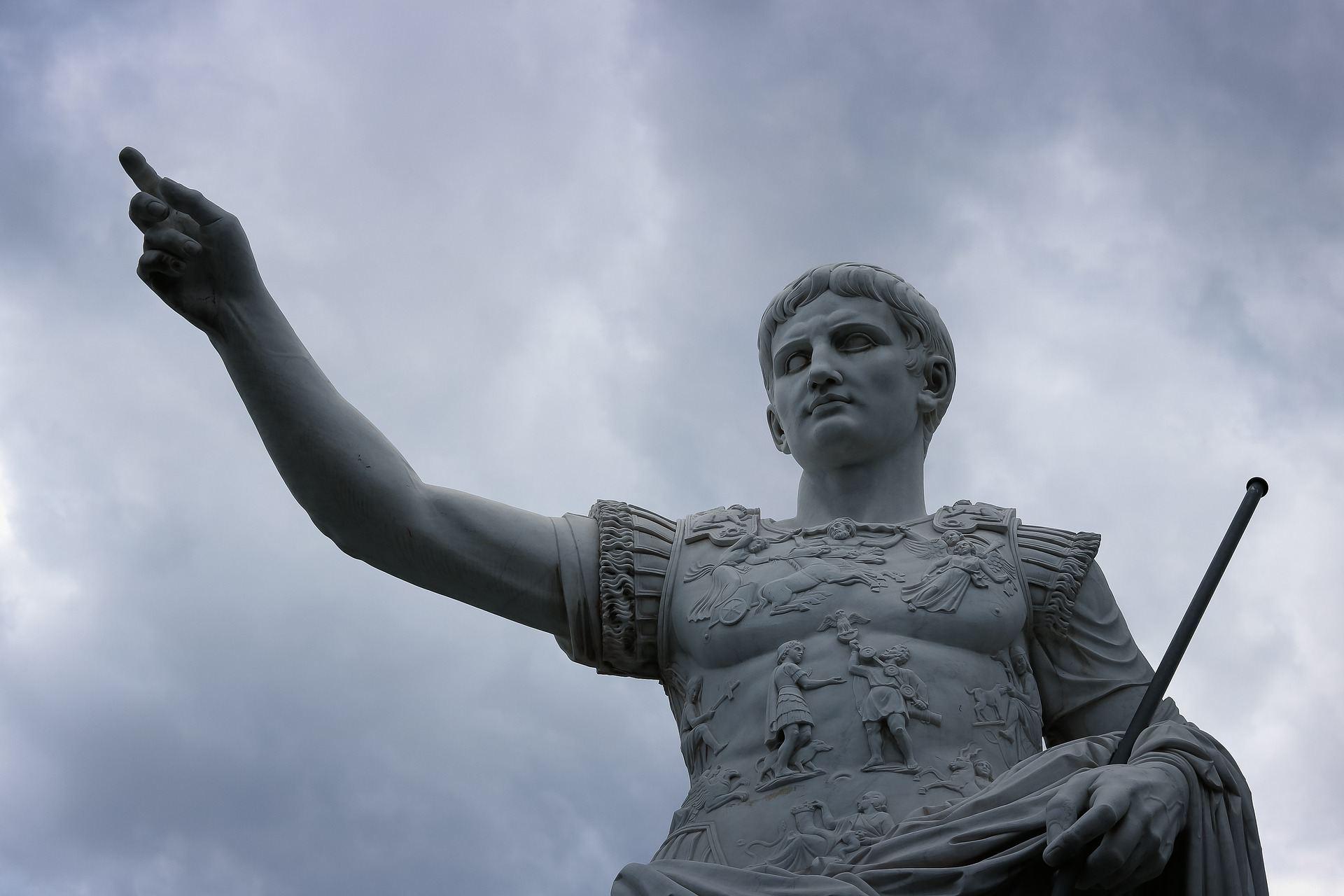 Statue of Julius Caesar against a stormy sky.