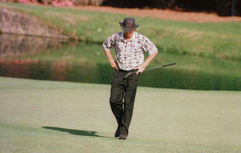 Greg Norman looks to the ground in dejection after missing another putt during the final round of the 1996 Masters