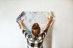 Young woman looking at map