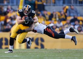 PITTSBURGH, PA - Dec. 23, 2012: Antonio Brown #84 of Pittsburgh Steelers tries to escape the diving tackle of Rey Maualuga #58 of Cincinnati Bengals.