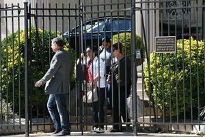 Cuban diplomats being expelled from their embassy in Washington, D.C.