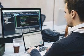 Man doing web design at desk.