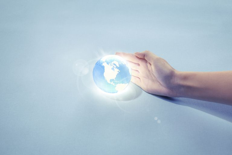 hand with glowing globe