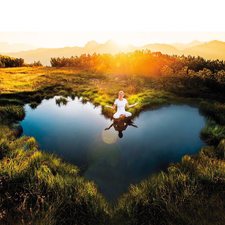 Meditating at a heart-shaped pond