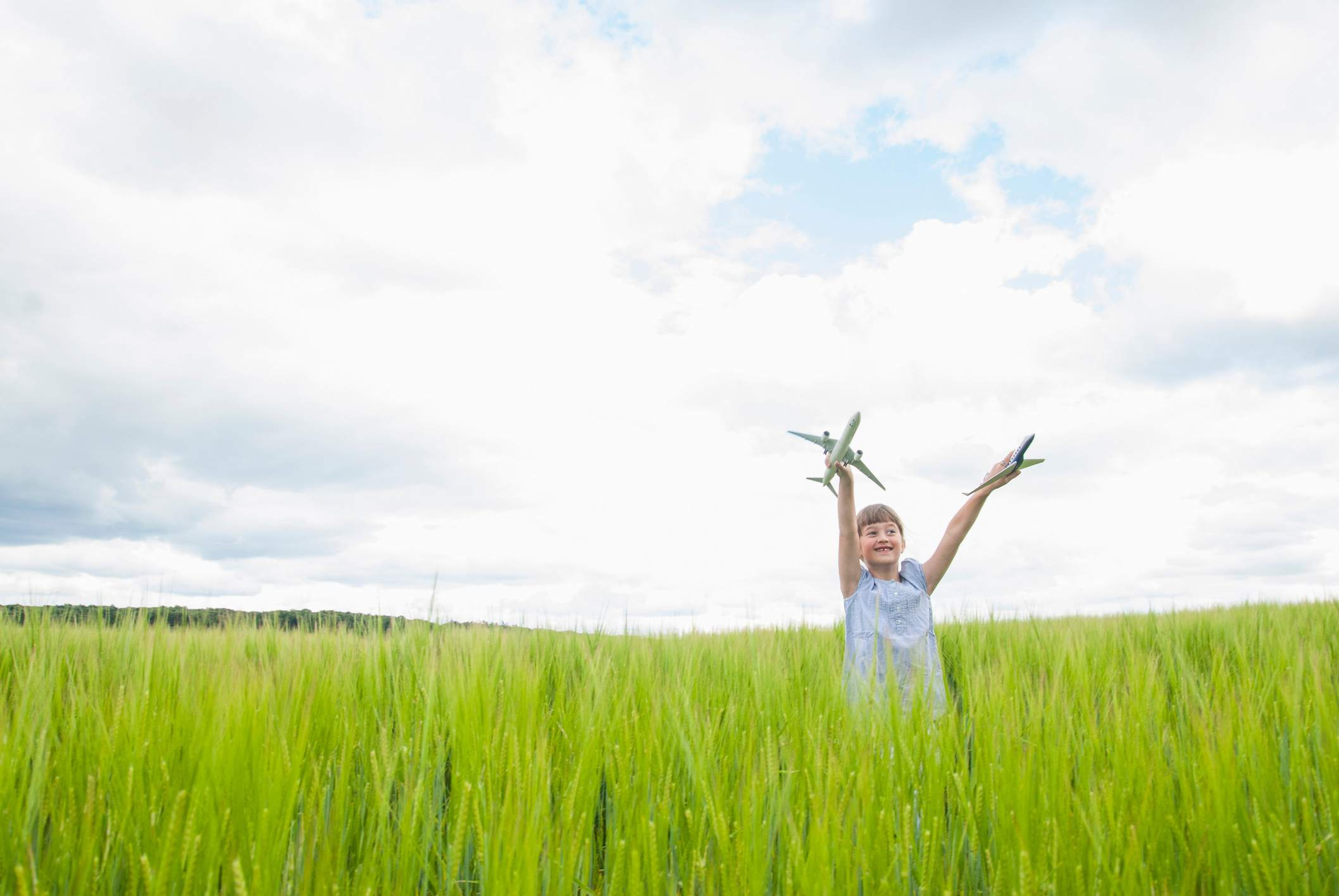 Girl in field with airplanes