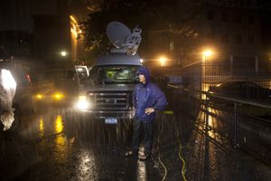 Jim Cantore in severe weather at night reporting for The Weather Channel.