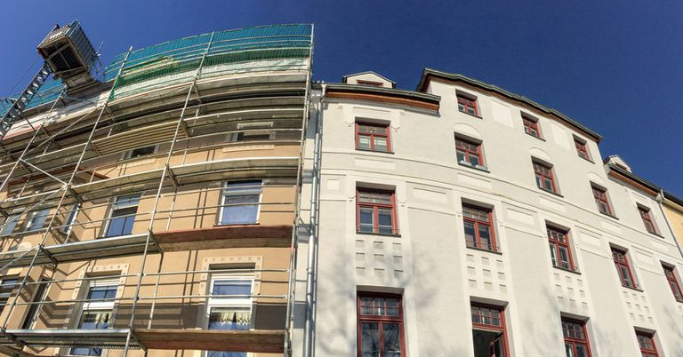 Old to new: Residential building facades before and after renovation.