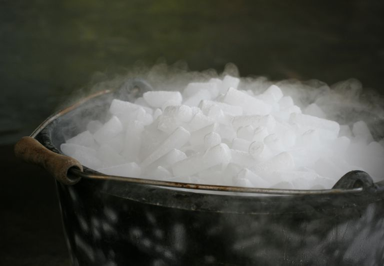 Dry Ice in a bucket producing steam.