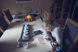 Blond girl writing letter