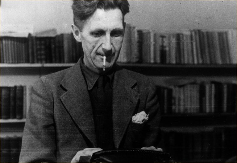 George Orwell (Eric Blair), standing with a cigarette in his mouth1903-1950