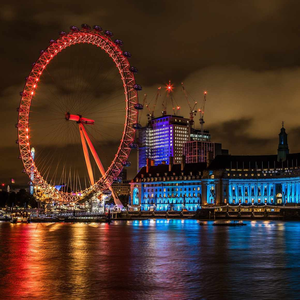 The London Eye at night all lit up.