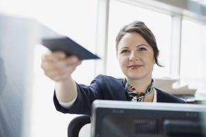 Airport customer service representative holding passport