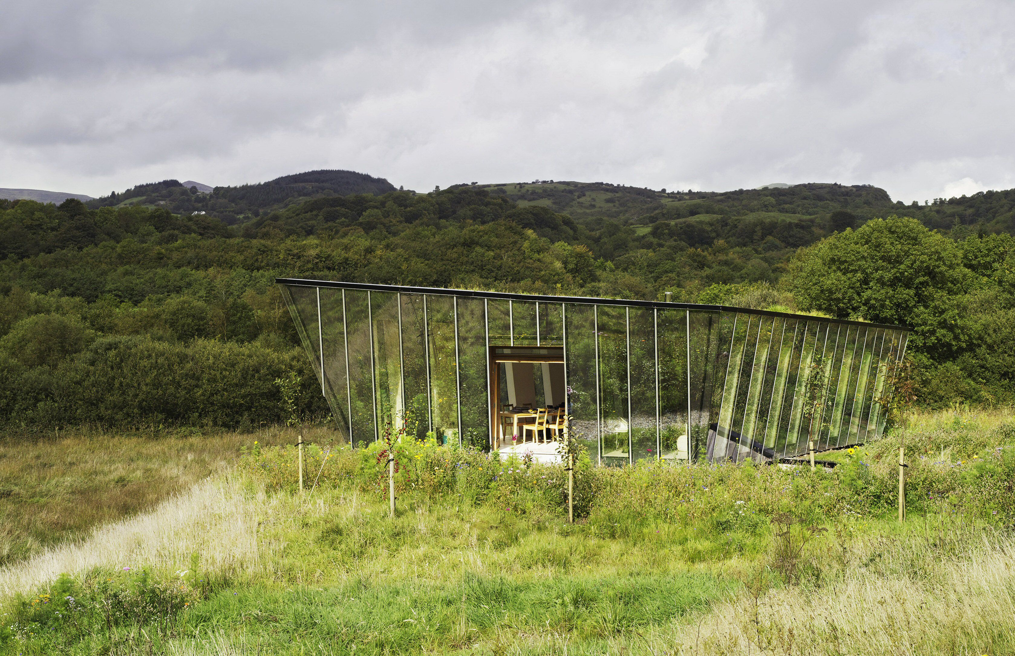 Glass house with green roof blends into Irish countryside, the Mimetic House by Irish Architect Dominic Stevens, Dromahair, County Leitrim, Ireland, 2006
