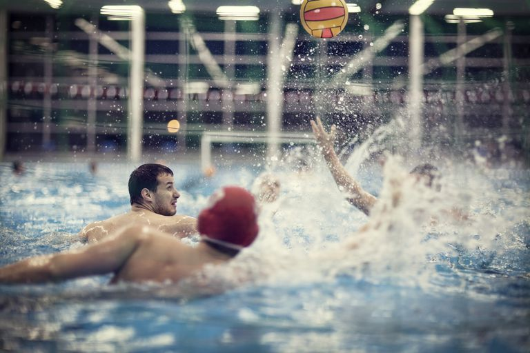 A group of men play water polo