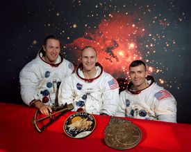 three Apollo 13 crew members with early navigation tools