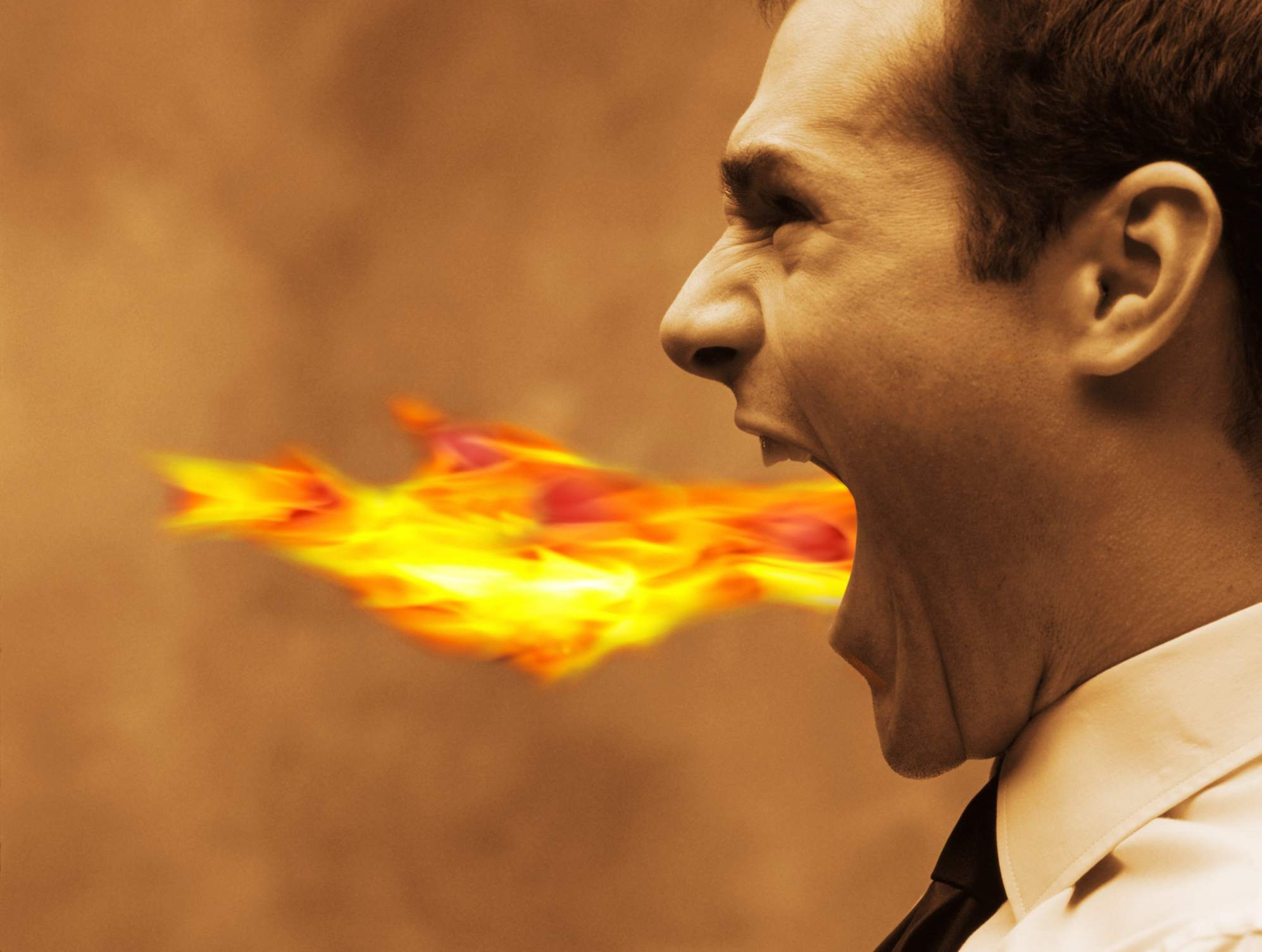 image of a man with flames shooting from his mouth