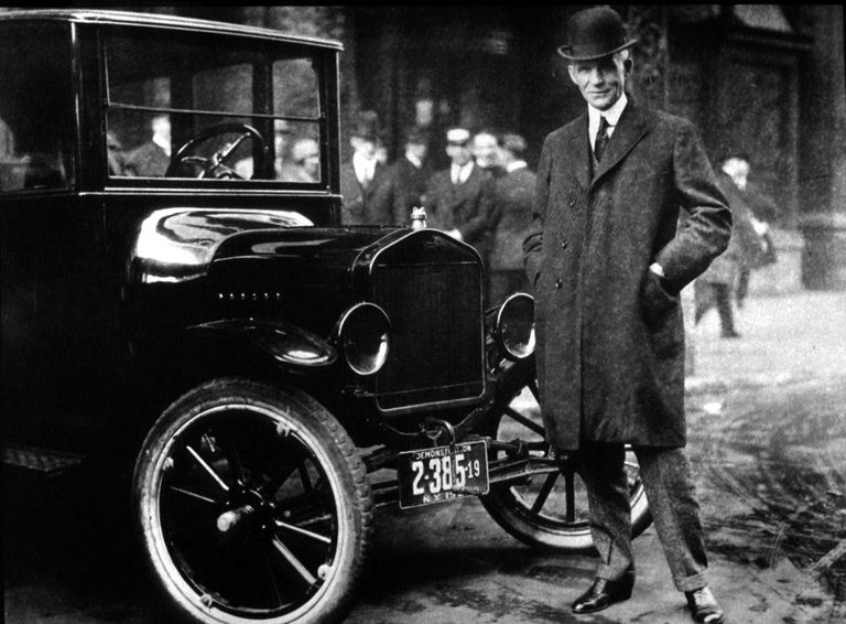 Hanry Ford in front of a Model T