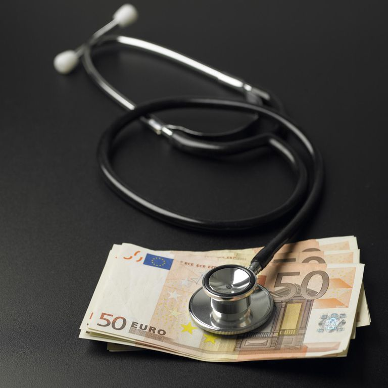 Stethoscope sounding pile of Euro currency